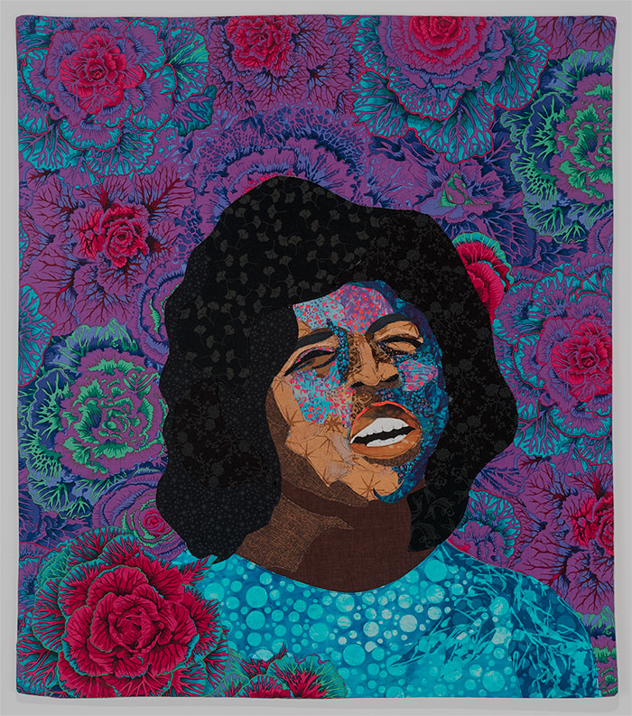 Fabric art of woman singing with flowers behind her by Alice Beasley